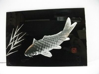 The relief of the pure silver carp. There is a signature.Japanese antique