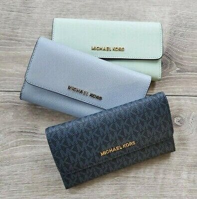5b26002134b64 NWT Michael Kors Jet Set Travel Large Trifold Leather   PVC Signature Wallet