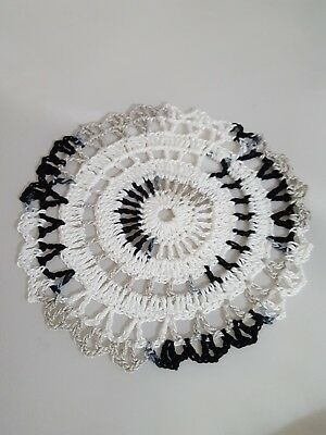 White in Shady Black Bumblebee doily Approximately 5 Inches.