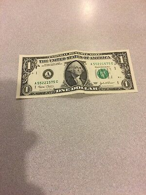 One Dollar Bill . The numbers on the left side are darker.