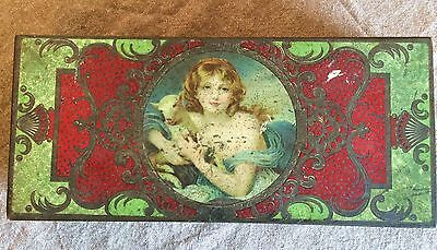 Edwardian tin with picture of girl holding lamb