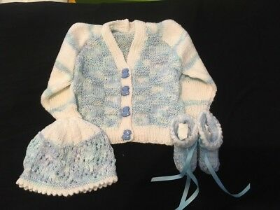 Hand knitted baby white and blue check and light move thought with dog buttons
