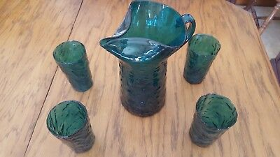 vintage blue glass pitcher and 4 glasses