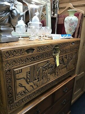 Chinese camphor wood blanket chest profusely carved with Oriental Design!