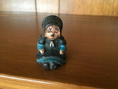 Vintage Cast Iron Amish Girl Sitting