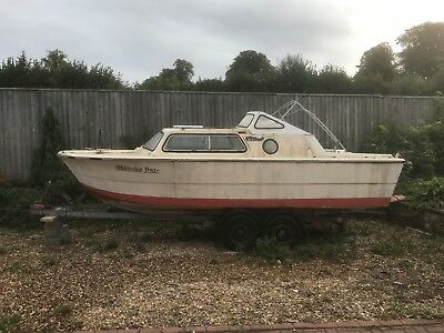 Canal cabin cruiser with trailer