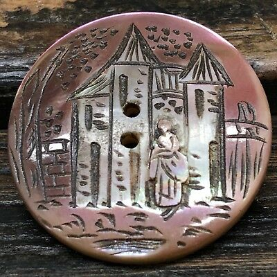 Antique hand carved pearl button, woman and castle design