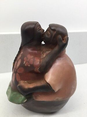 Chulucanas Peruvian art pottery signed by artist Kissing Couple