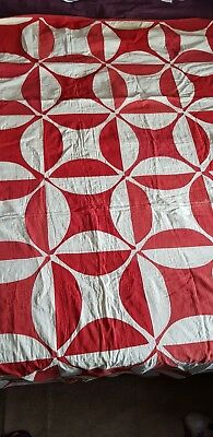 A late 19th/early 20th Century red and white patterned patchwork quilt
