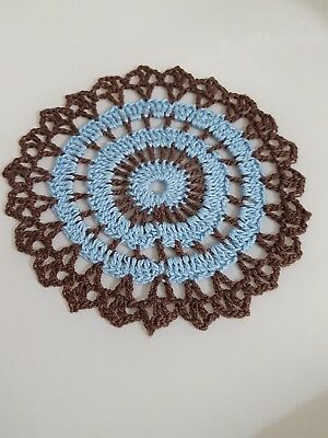 Baby Blue in Brown Bumblebee doily Approximately 5 Inches.