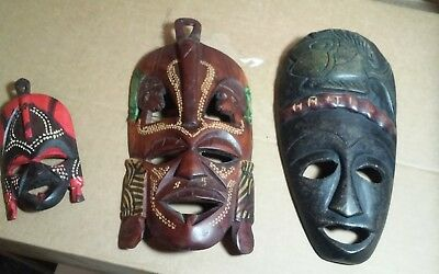 3 older carved wood mask's from Africa,1 marked Haiti