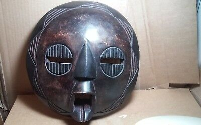 Interesting large carved wooden African wall sculpture,mask bout 12 x 11
