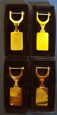 Lot Of 4 Coca Cola Goldtone Olympic Key Chains in boxes