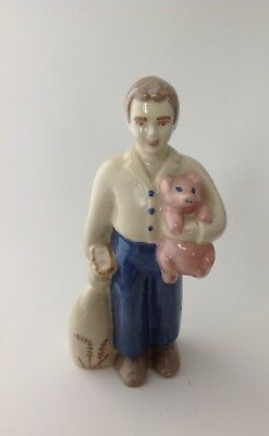 """Man Holding Piglet Figurine Hand Painted With Bag of Wheat 5 3/4"""" China Ceramic"""