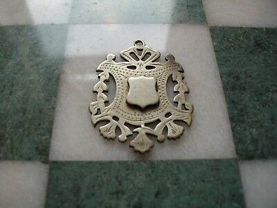 An early 20thC Makin's Silverite fob medallion with vacant cartouche