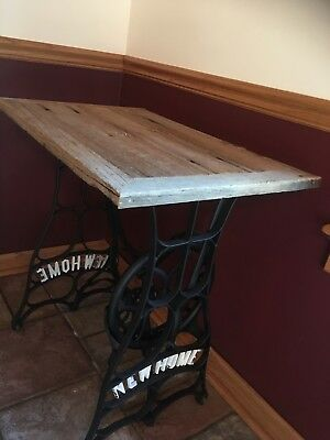 Vintage sewing machine base table with reclaimed wood top