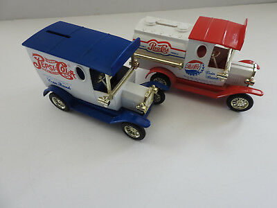 Pair of Pepsi Cola Metal Coin Bank Trucks