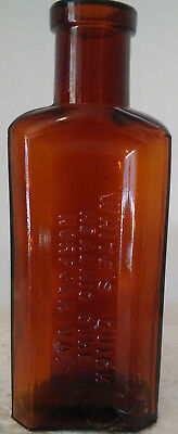 White's Quick Healing Cure, Norfolk, Virginia Embossed Amber Bottle