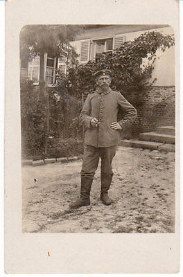 Postcard WW1 RPPC German Soldier Smoking Real Photo Military Boots Uniform WWI