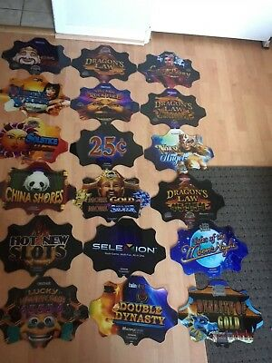 LOT OF 18 KONAMI CASINO SLOT MACHINE TOPPER PLAQUES INSERTS Used Condition #1