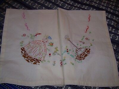 "Small tablecloth with embroidered crinoline ladies. 33"" square.Good condition."