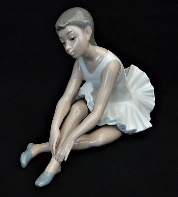 NAO/Lladro Ballerino Sitting in Tutu Leaning Forward With Outstretched Arms