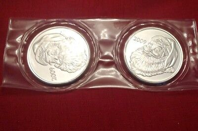 2 (two) sold Silver Christmas Santa Rounds, sealed