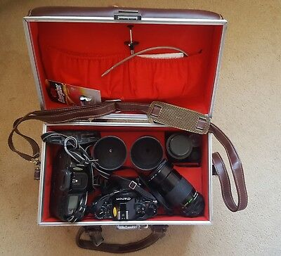 Canon A1 camera with 2 lenses, 2x converter, flash unit,filters plus lots extras