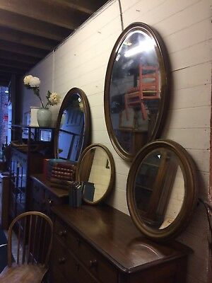 Lovely Pair Of Early 20th Century Oval Bevelled Wall Mirrors In Mahogany Frames