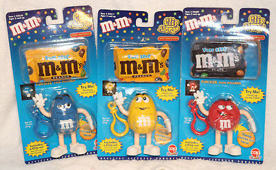 3 M&M's Clip Alongs Collectiable Candy Dispensers. Blue, Yellow & Red. NIP