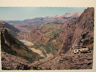 "1960 's? JEEP CJ-6, approaching Telluride, CO. 6"" x 4"" color postcard"