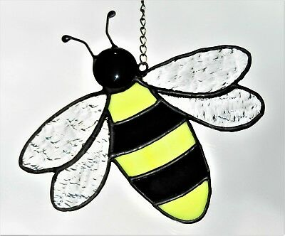 Hand crafted stained glass sun catcher. Bee