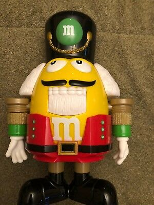 M&M candy dispenser Nutcracker Sweet. Excellent Condition. Yellow And Red.