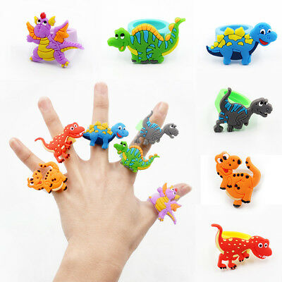 Lots Cute Cartoon Dinosaur Finger Rings Soft PVC Rubber Kids Toy Jewelry Gift us