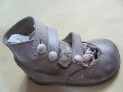 Cute pair of antique hard sole white leather button strap toddler shoes