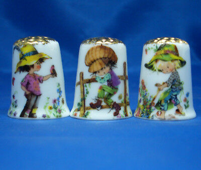 Fine Porcelain China Thimbles - Set Of Three Boys In Bonnets Gold Top