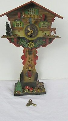 Vtg. Cuckoo style Clock West Germany Girl on a Swing Deer, With Key