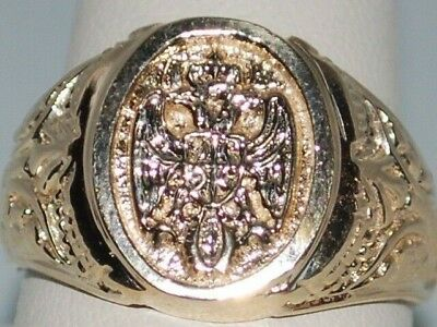 14k Gold ring with a double headed eagle with crown and weighs 10.3 Grams