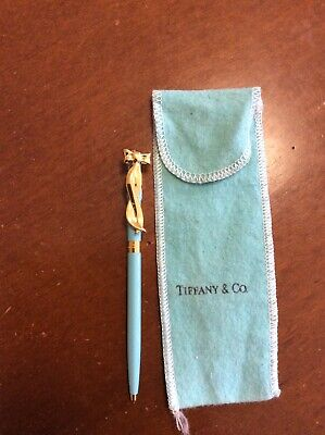 tiffany and co vintage retractable pen, blue lacquer with gold bow. Never used