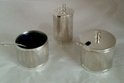 Elizabeth ll sterling silver three piece cruet set. Birmingham1973.By Chatterley