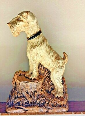 Vintage Syrocco Airedale Terrier Dog Standing on Tree trunk