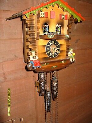 Musical Cuckoo Clock  Spinning  Man And Ladies See Video