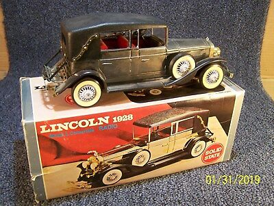 Vintage transistor radio in shape of a 1928 Lincoln Town Car.Car v clean-works