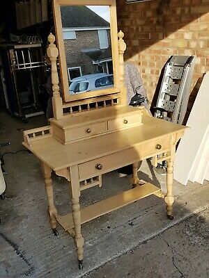Antique pine dressing table with mirror and drawers.