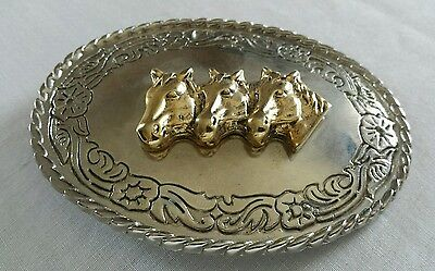Three 3D Gold Toned Horses Western Belt Buckle Silver Toned Floral Background