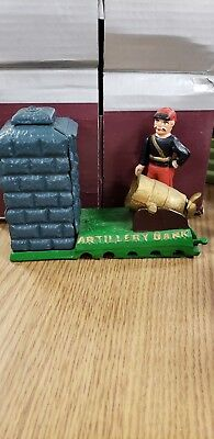 Cast iron Artillery Mechanical Bank with cannon and soldier that is very heavy