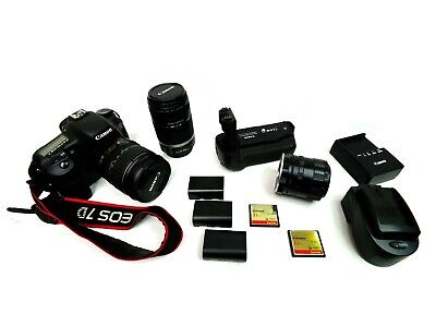 Canon EOS 7D 18.0MP Digital SLR Camera with lenses and accessories.
