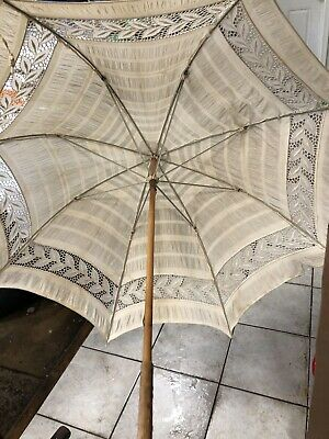 antique old or vintage parasol In Need