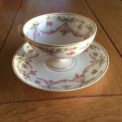 Limoges pink floral tea cup and saucer. excellent condition.