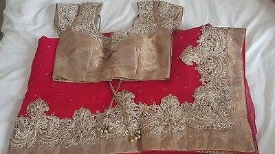 Red saree with blouse and heavy border , Excellent condition , worn once only